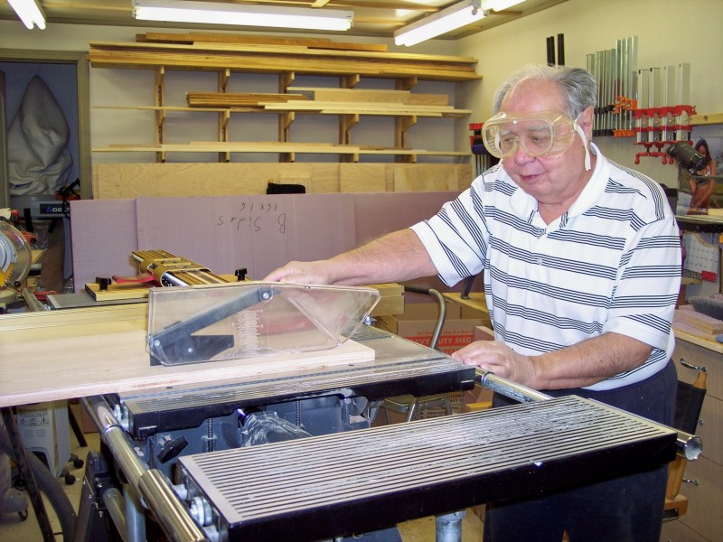 Picture of Max Robinson in his wood shop