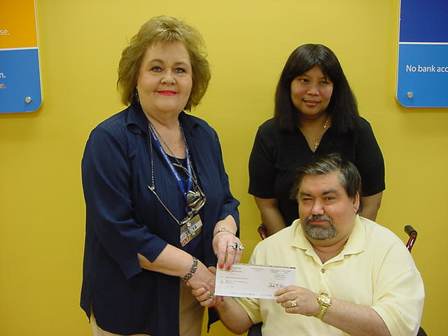 Photo of David Welch receiving Grant check