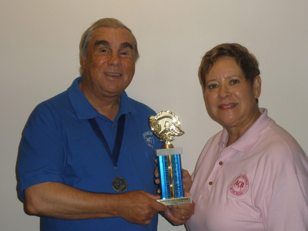 Ron and Palma holding ACB Walk trophy